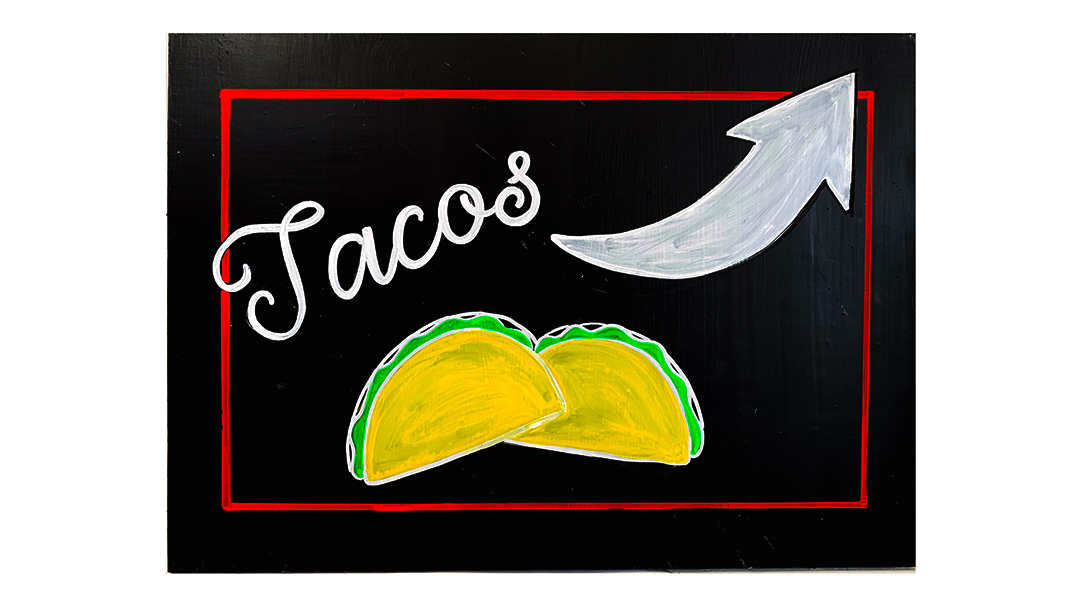 a chalkboard with tacos