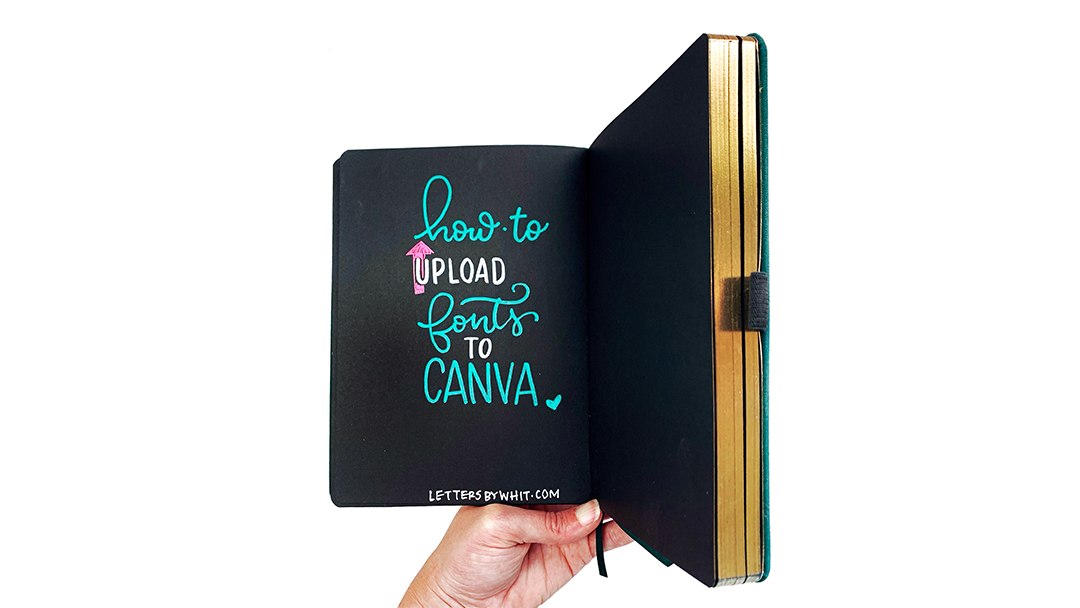 an open bullet journal with how to upload fonts text
